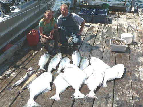 Happy D&D Fishing Charters customers proudly show off their catch.
